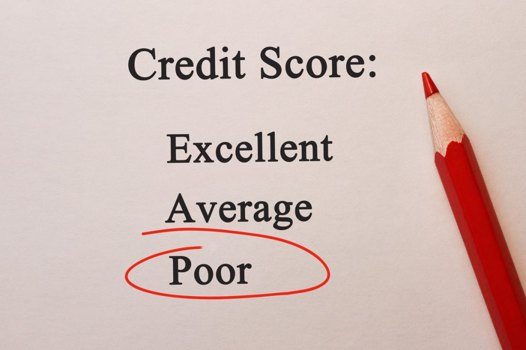 Credit Score Poor in red circle with pencil on textured paper