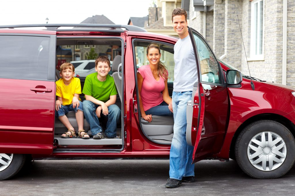 Smiling happy family and a family car sideview